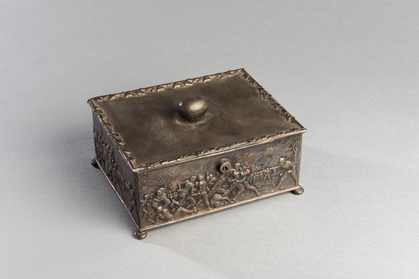 Victorian metalware box with rugby decoration, embossed