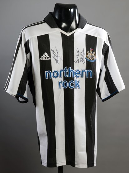 Newcastle United replica jersey signed by Sir Bobby