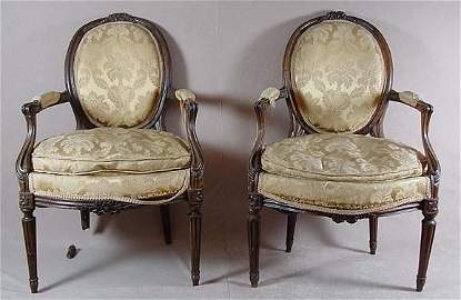 506: PAIR OF LOUIS XVI STYLE FAUTEUIL, WALNUT 19TH C.