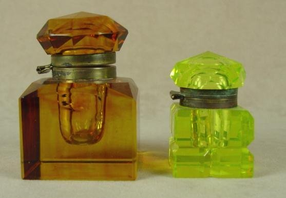 323: 2 FACETED GLASS INKWELLS