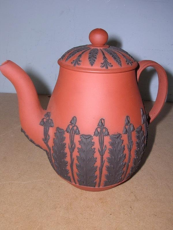6: A BLACK ON RED JASPER TEA POT