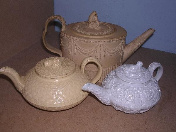 8: THREE VARIOUS TEA POTS