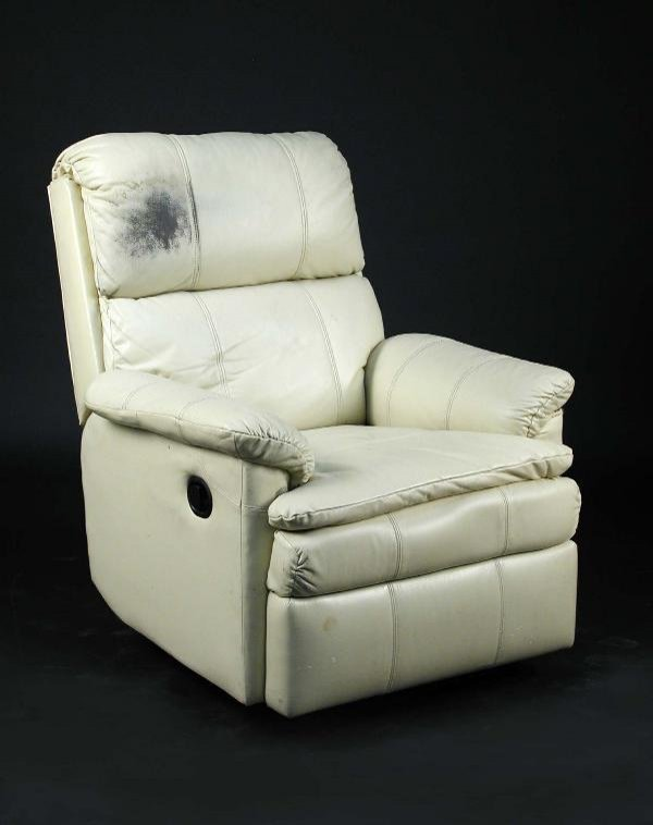 690: 'SYD'S CHAIR', A CREAM LEATHER RECLINING ARMCHAIR