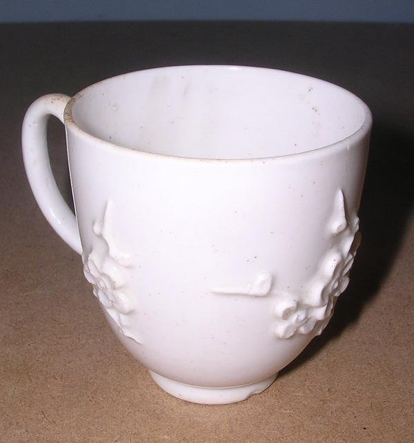 27: A BOW BLANC DE CHINE COFFEE CUP