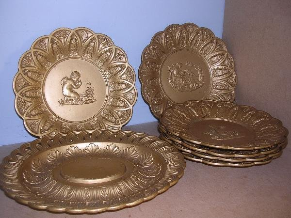 9: A SET OF SIX LATER GILT SHORE POTTERY PLATES AND