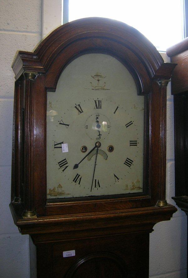 1002: AN OAK EIGHT DAY LONGCASE CLOCK