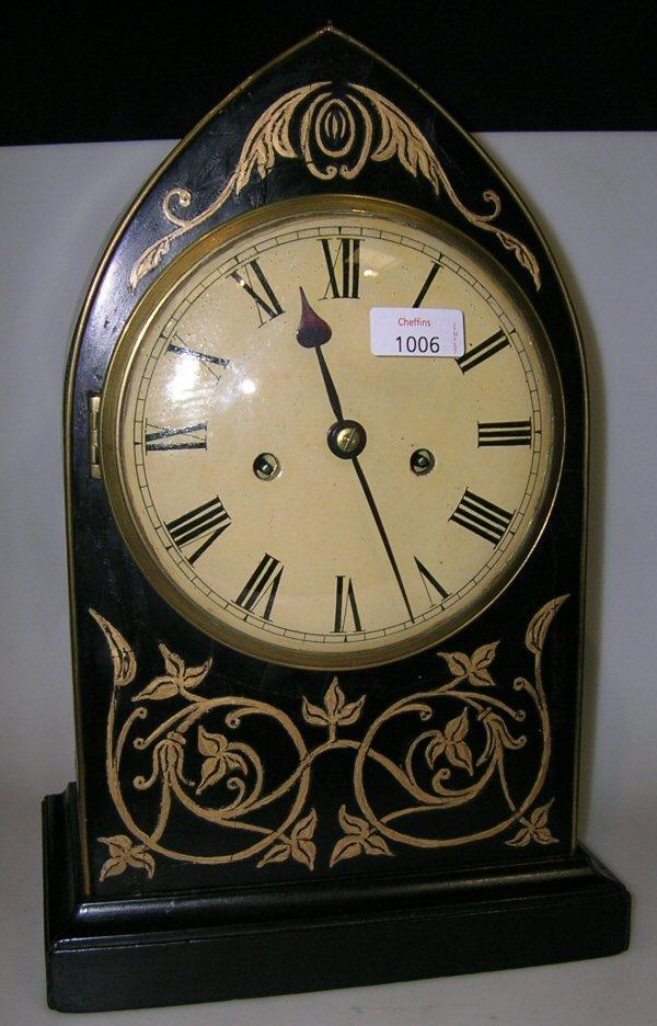 1006: AN EBONISED MANTEL CLOCK