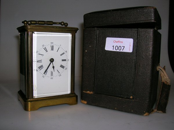 1007: A FRENCH BRASS CARRIAGE TIMEPIECE