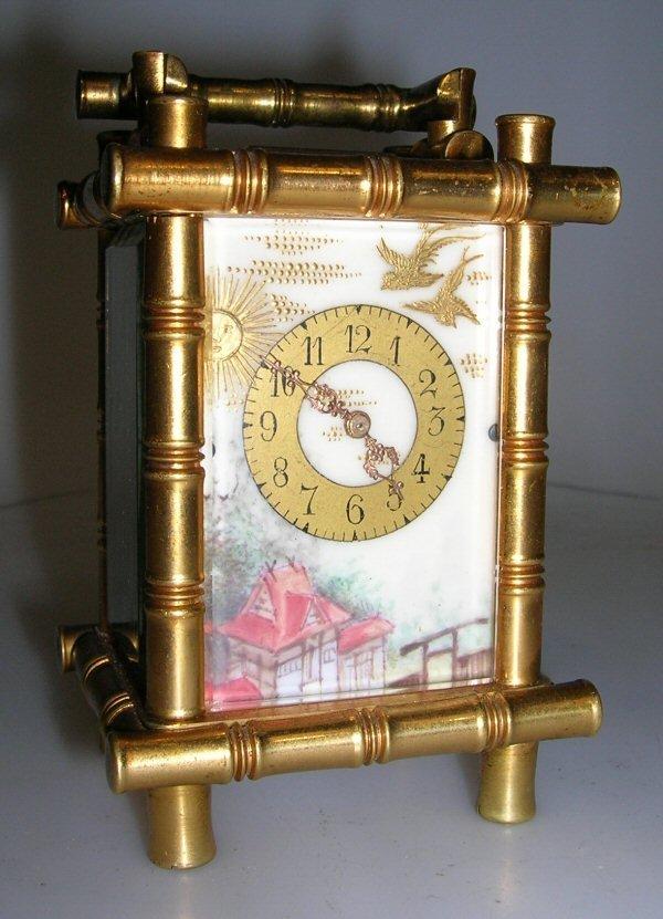 1009: A SMALL GILT BRASS CARRIAGE TIMEPIECE