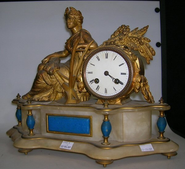 1011: A GILT BRACKET CLOCK WITH A RECLINING FIGURE, AND