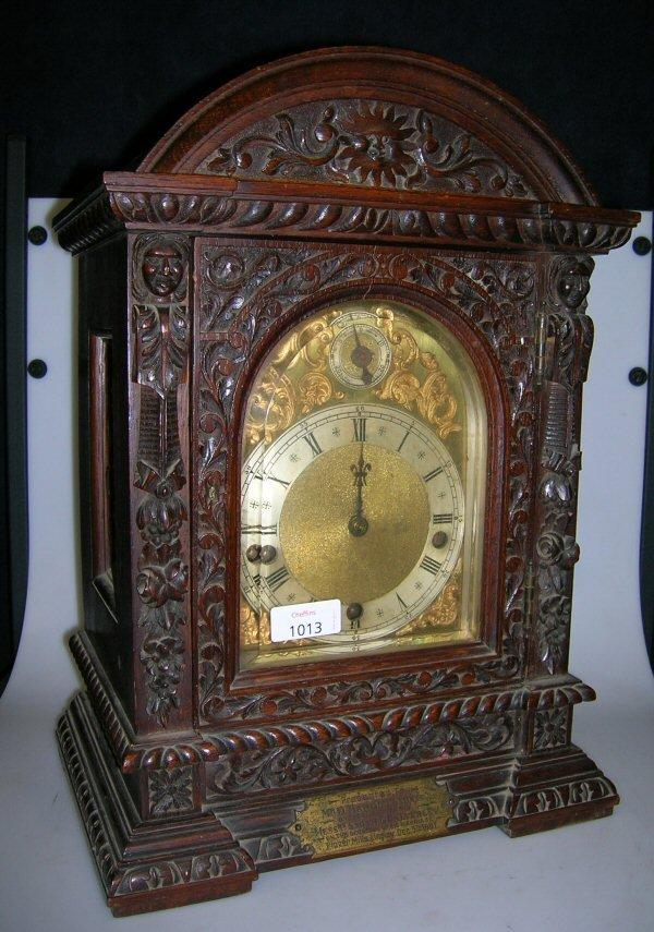 1013: A GERMAN OAK BRACKET CLOCK