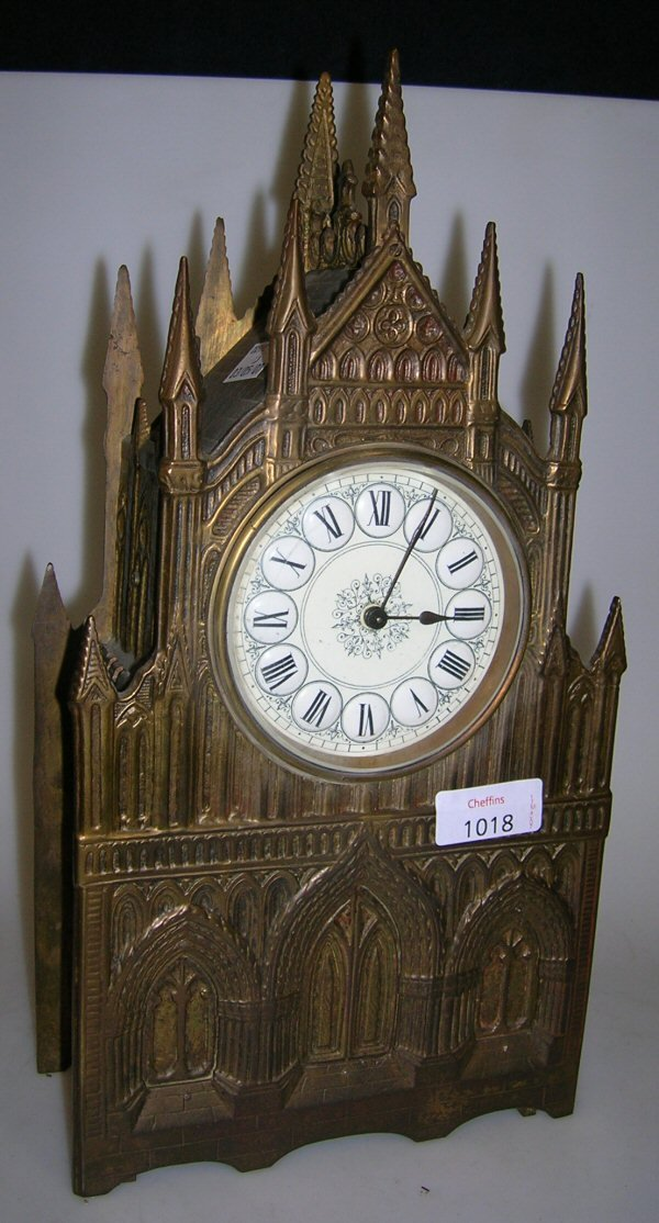 1018: A BRASS CATHEDRAL CASE MANTEL CLOCK