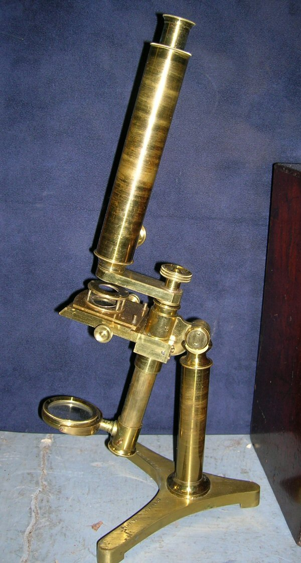 1056: A MAHOGANY CASED MICROSCOPE BY GOGERTY WITH