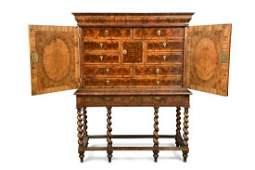 A late 17th century laburnum oyster veneer cabinet on
