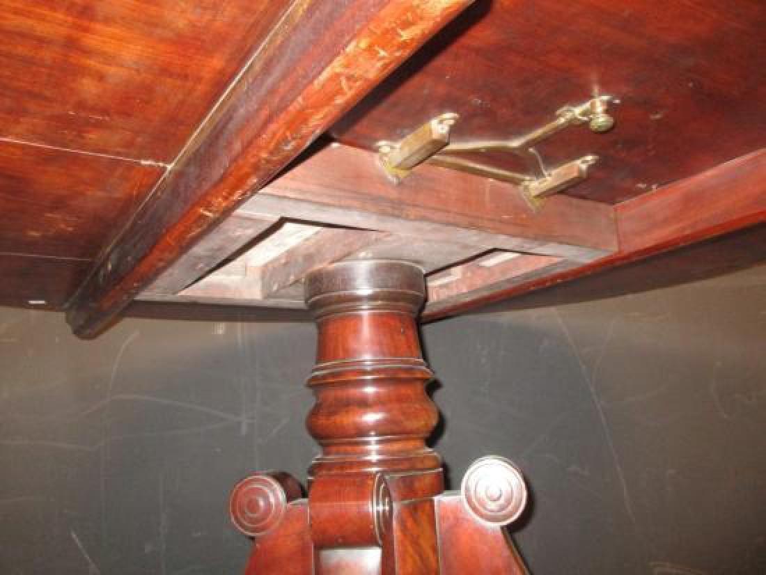 A Regency mahogany oval pedestal dining table, - 2