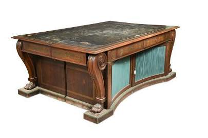 A Regency rosewood and brass inlaid library table in