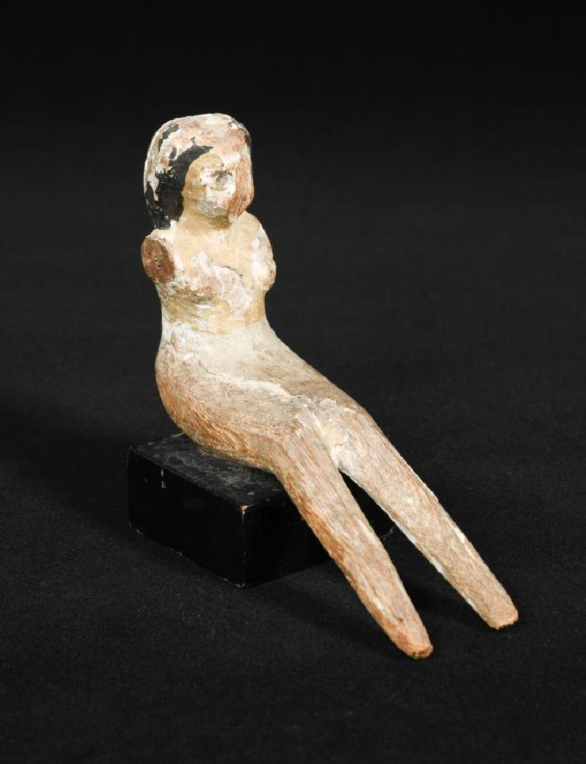 An Egyptian wood seated female,