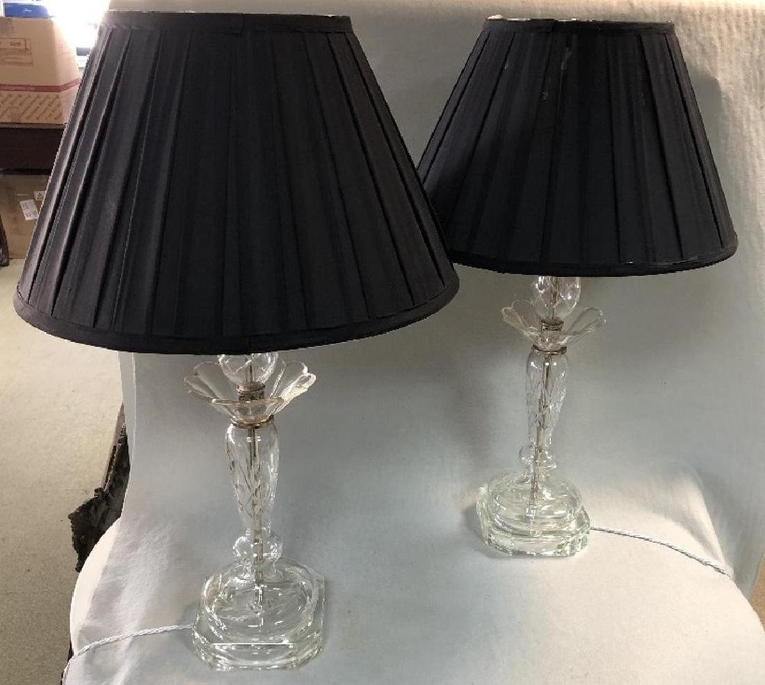 A pair of cut glass table lamps,