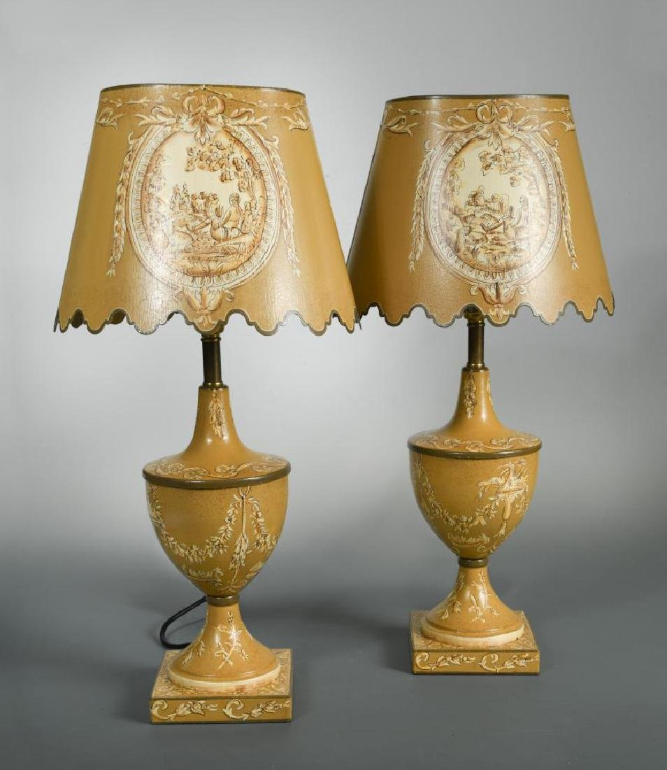 A pair of toleware table lamps and shades,