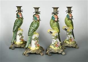 A set of four gilt metal mounted porcelain parrot