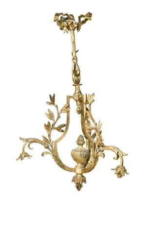 An ormolu hanging lamp with ribbons and leaves