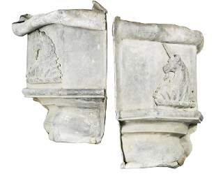 A pair of 18th or early 19th century crested lead drain