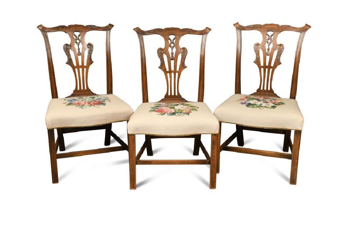 A set of three George III mahogany dining chairs,