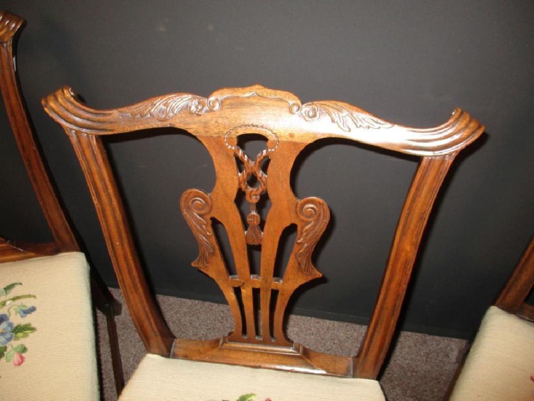 A set of three George III mahogany dining chairs, - 2