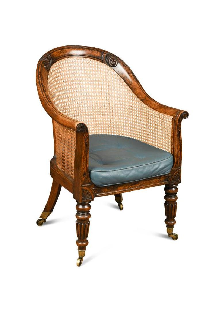 A Regency faux rosewood bergere library chair,