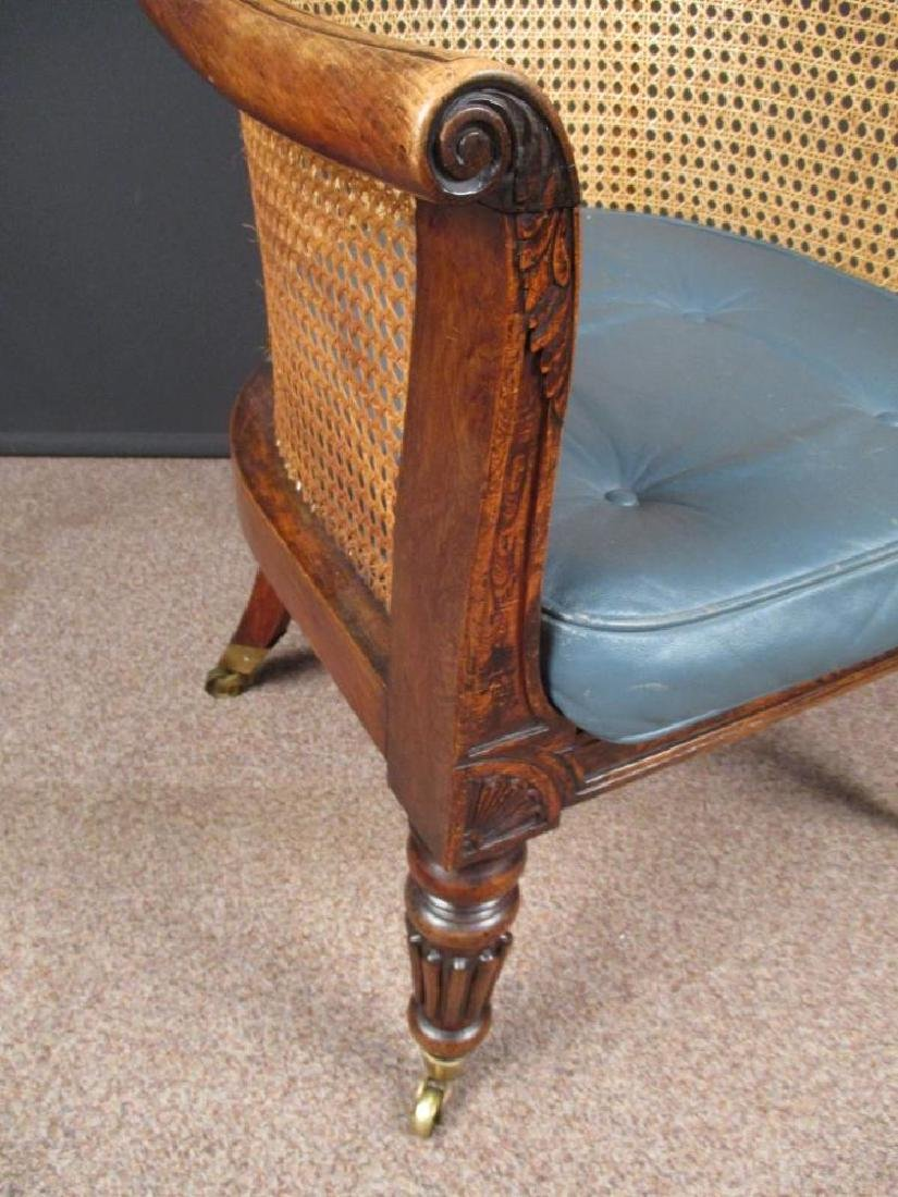 A Regency faux rosewood bergere library chair, - 2