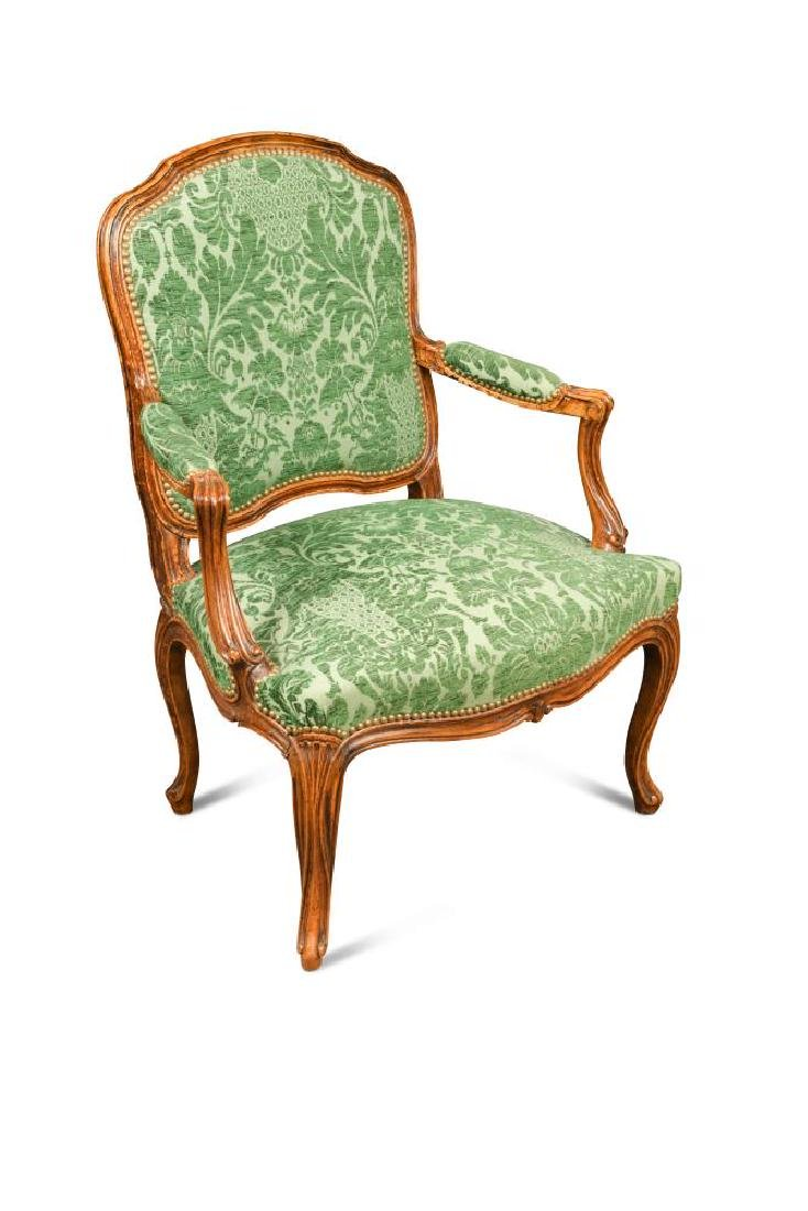 A Louis XV style French walnut armchair