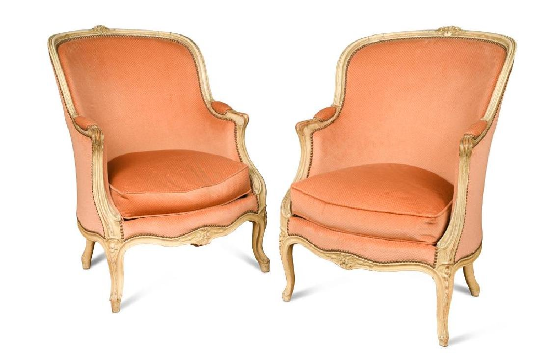 A pair of Louis XV style French fauteuil,