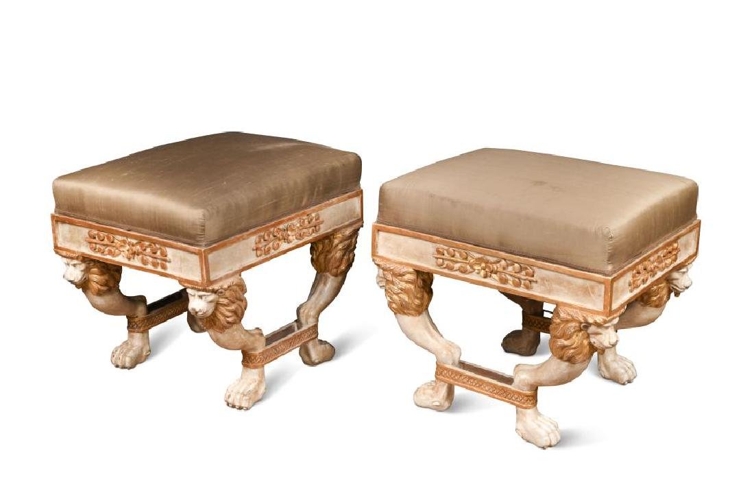 A pair of Regency style parcel gilt stools,