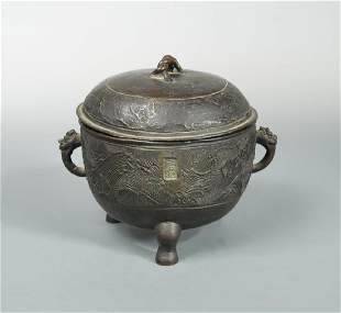 A bronze ritual tripod food vessel Ding and cover Yuan