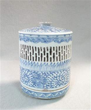 A 19th century blue and white candle lantern