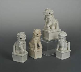 A collection of four Blanc de Chine Qilin joss stick