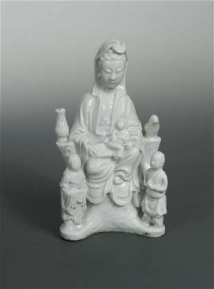 A Dehua Guanyin with her a child and acolytes Qing