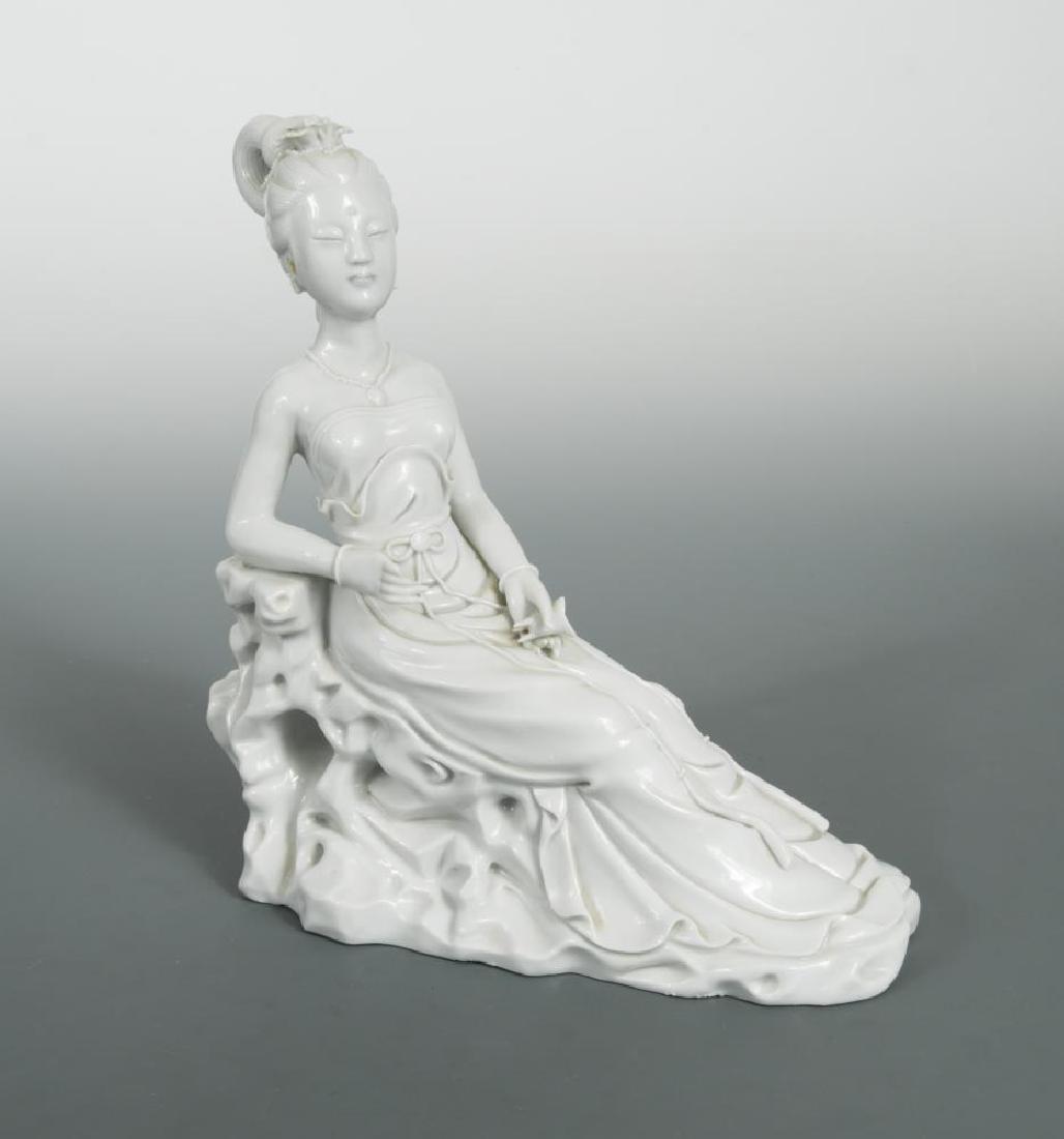 A Dehua sculpture of a lady, 20th century,