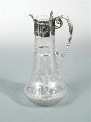 A late Victorian silver plated claret jug