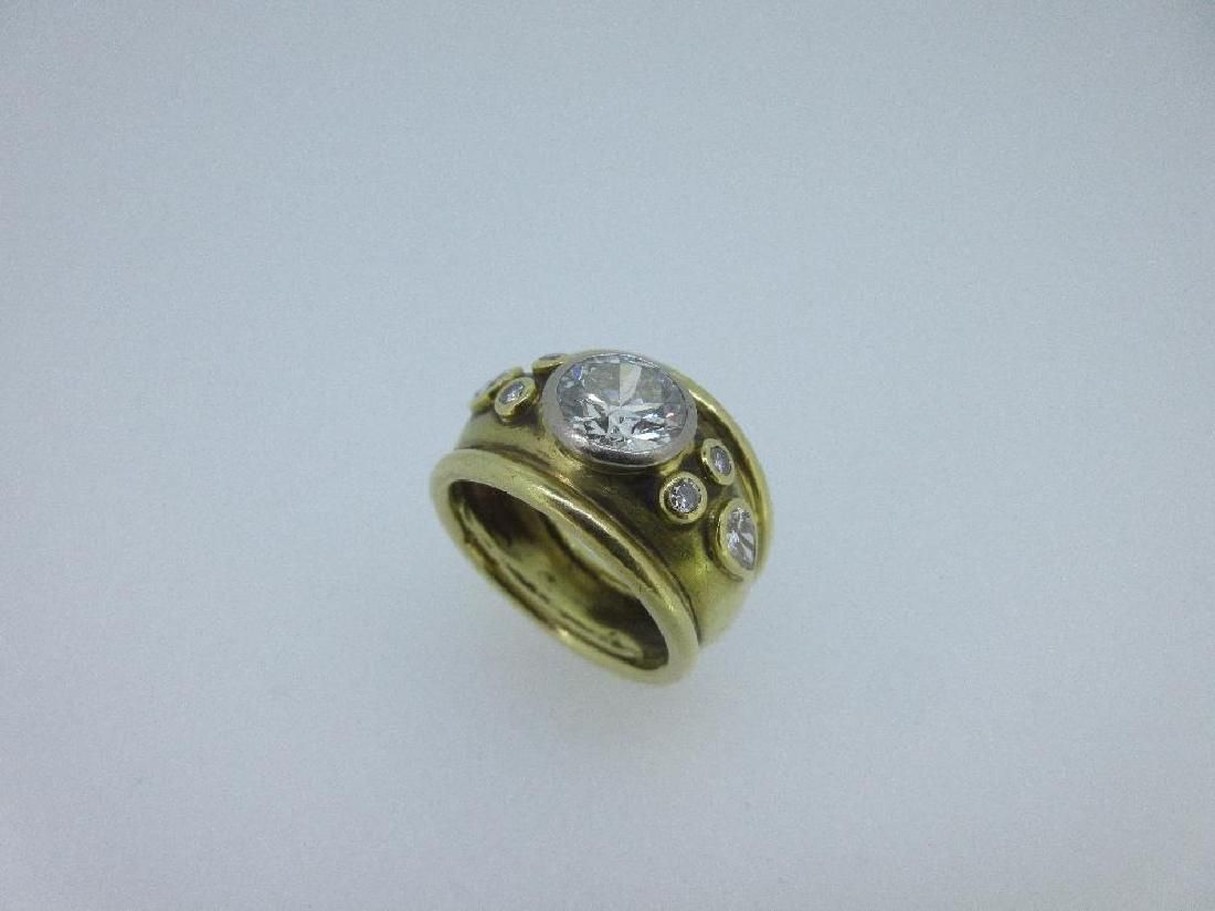 An 18ct gold hand made diamond ring in the style of