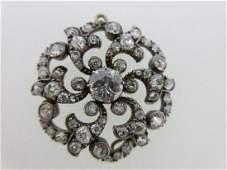 A late 19th century circular diamond brooch / pendant,