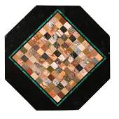 A 19th century octagonal black marble and pietra dura