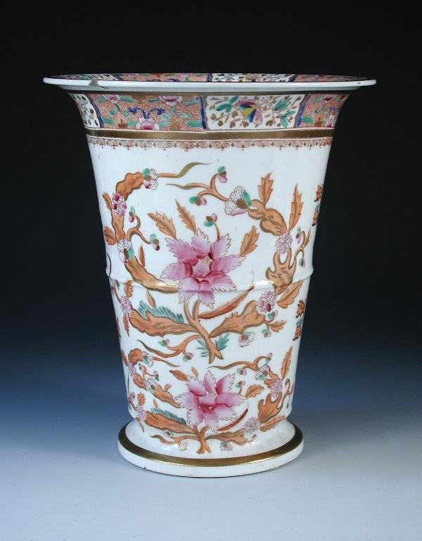 24: A large porcelain vase decorated peach and pink
