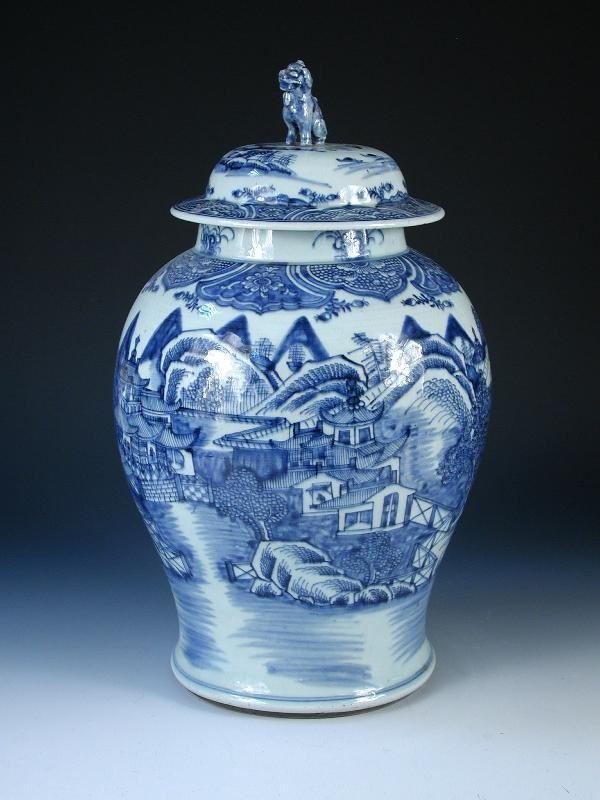 90: A CHINESE BLUE AND WHITE BALUSTER VASE AND COVER,
