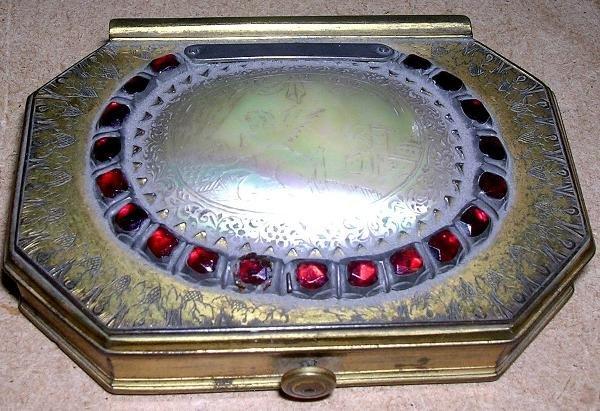 600: A GILT BRASS SNUFF BOX, OCTAGONAL, INSET WITH