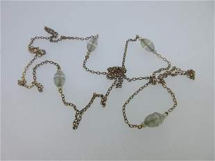 A vintage chain necklace with seed pearls and rock