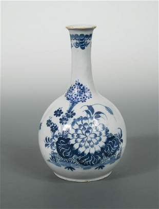 A Delft blue and white water bottle, probably