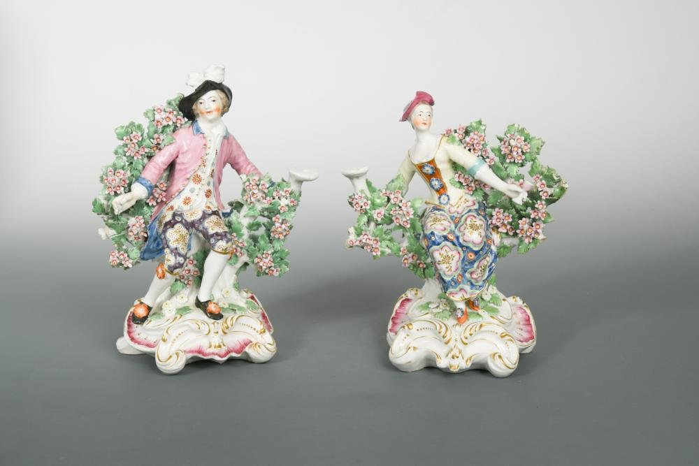 A pair of Chelsea bocage figural candlesticks, circa