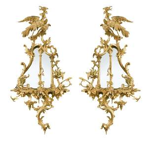 A pair of 18th century Chippendale style carved