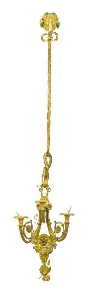 A set of four Louis XVI style ormolu three branch